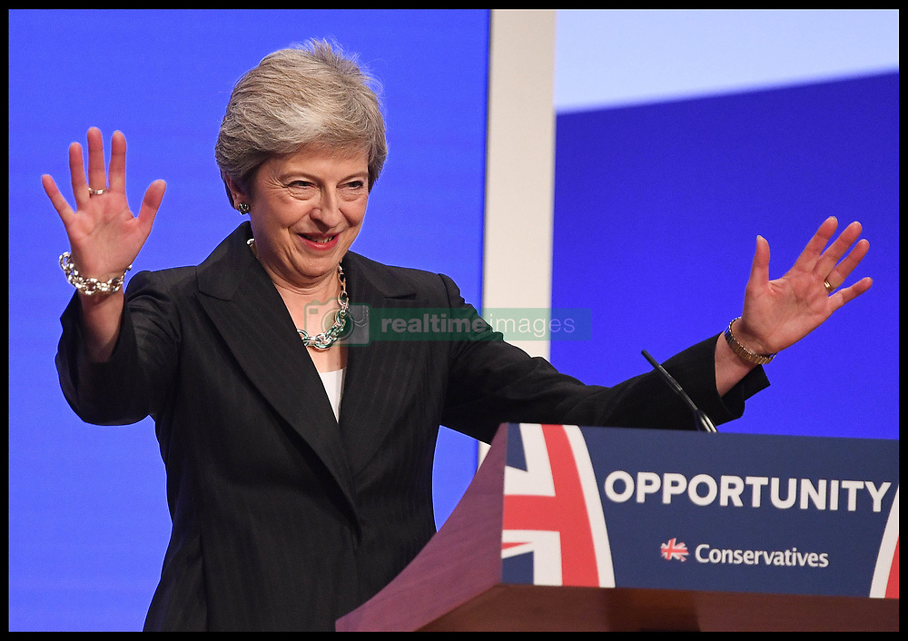 October 3, 2018 - Birmingham, Birmingham, United Kingdom - Conservative Party Conference- Day Four. The Prime Minister Theresa May dancing to ABBA's Dancing Queen as she arrives on stage to deliver her keynote speech on the final day of the 2018 Conservative Party Conference in Birmingham. (Credit Image: © Andrew Parsons/i-Images via ZUMA Press)