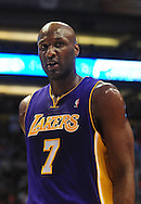 Oct. 29 2010; Phoenix, AZ, USA; Los Angeles Lakers forward Lamar Odom (7) reacts on the court against the Phoenix Suns during the first half at the US Airways Center. The Lakers defeated the Suns 114-106.  Mandatory Credit: Jennifer Stewart-US PRESSWIRE.