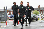 Forest Green Rovers Farrend Rawson(6), Forest Green Rovers Junior Mondal(25) and Forest Green Rovers goalkeeper James Montgomery arrive at the ground during the EFL Sky Bet League 2 match between Crewe Alexandra and Forest Green Rovers at Alexandra Stadium, Crewe, England on 27 April 2019.