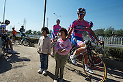 Lampre poses for some images with local children at the start of the Tour of Beijing's ten team Pre-Ride orgainized by the Chinese welcoming group.