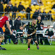 TJ Perenara (captain) passes during the Super rugby union game (Round 14) played between Hurricanes v Reds, on 18 May 2018, at Westpac Stadium, Wellington, New  Zealand.    Hurricanes won 38-34.