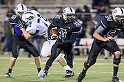 Cedar Ridge runningback Marcus Friar gains yardage against McNeil Thursday at Kelly Reeves Athletic complex.  (LOURDES M SHOAF for Round Rock Leader)