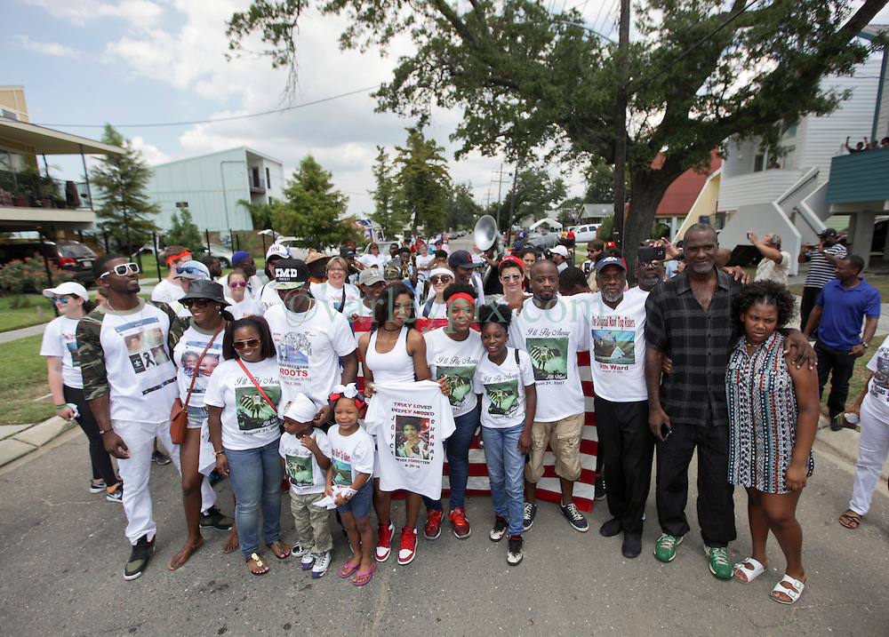 29 August 2015. Lower 9th Ward, New Orleans, Louisiana.<br /> Hurricane Katrina 10th anniversary memorials.  <br /> Robert Green leads hurricane survivors on a 2nd line parade to celebrate those who perished in the storm, including his own mother and grand daughter.<br /> Photo credit©; Charlie Varley/varleypix.com.