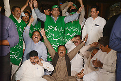 "October 5, 2018 - Lahore, Punjab, Pakistan - Pakistan supporters of opposition leader Shahbaz Sharif chant slogans outside the office of National Accountability Bureau(NAB) following the opposition leader Shahbaz Sharif arrest, in Lahore on October 05, 2018. Pakistan's anti-graft body announced that it had arrested the country's opposition leader"" former Chief Minister Punjab and Pakistan Muslim League-Nawaz (PML-N) President Shahbaz Sharif, over his alleged links to a multi-million dollar Ashiana Housing Scheme. officials said, the latest corruption allegation against the Sharif political dynasty that was ousted from power by ex-cricketer Imran Khan in elections this summer. (Credit Image: © Rana Sajid Hussain/Pacific Press via ZUMA Wire)"