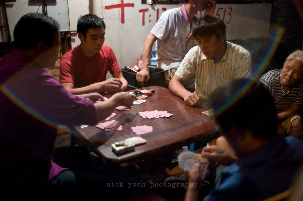 Gambling on the sidewalk, in the area south of Xintiandi, bordered by Madang, Fuxing Middle, Hefei and Jinan Roads. Shanghai, China.