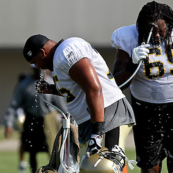 August 6, 2011; Metairie, LA, USA; New Orleans Saints offensive lineman Cecil Newton (75) and George Foster (69) cool off during training camp practice at the New Orleans Saints practice facility. Mandatory Credit: Derick E. Hingle