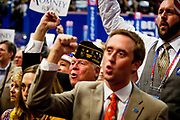 Delegates cheers USA-USA-USA as US Olympic athletes endorse Mitt Romney as their pick for President at the GOP National Convention at the Tampa Bay Forum.
