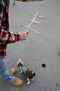 Manhattan, NY. Dec. 4, 2013. Ricky Syers heads to Washington Square Park to work, where he makes money showing his marionettes to passersby. The marionette is controlled by dozens of different strings. 12042013. Photo by Kayle Hope Schnell/CUNY Photo Wire