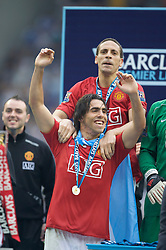 WIGAN, ENGLAND - Sunday, May 11, 2008: Manchester United's Rio Ferdinand and Carlos Tevez celebrate winning the Premier League for the 10th time during the final Premiership match of the season at the JJB Stadium. (Photo by David Rawcliffe/Propaganda)