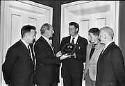 03/07/1963<br /> 07/03/1963<br /> 03 July 1963<br /> David Brown Tractor and Implements Maintenance Awards presented by Minister of Industry and Commerce Jack Lynch TD at the Shelbourne Hotel, Dublin. Picture shows Jack Lynch (2nd left) chatting with the winner of the main award.
