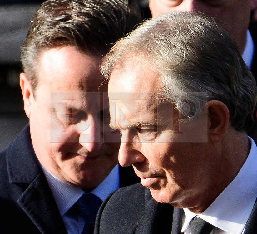 © Licensed to London News Pictures. 13/11/2016. London, UK.   Former British prime ministers DAVID CAMRON and TONY BLAIR attend a Remembrance Day Ceremony at the Cenotaph war memorial in London, United Kingdom, on November 13, 2016 . Thousands of people honour the war dead by gathering at the iconic memorial to lay wreaths and observe two minutes silence. Photo credit: Ben Cawthra/LNP