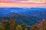 Autumn colors and distant mountains shortly before sunrise, as viewed from a Blue Ridge Parkway overlook near Boone