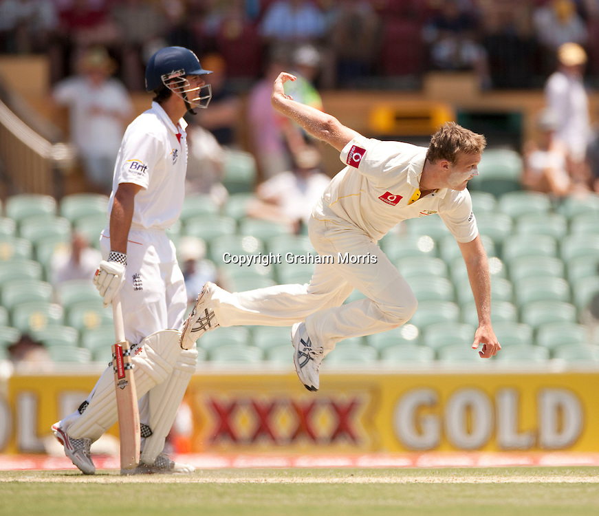 Doug Bollinger bowls past Alastair Cook during the second Ashes Test Match between Australia and England at the Adelaide Oval. Photo: Graham Morris (Tel: +44(0)20 8969 4192 Email: sales@cricketpix.com) 4/12/10