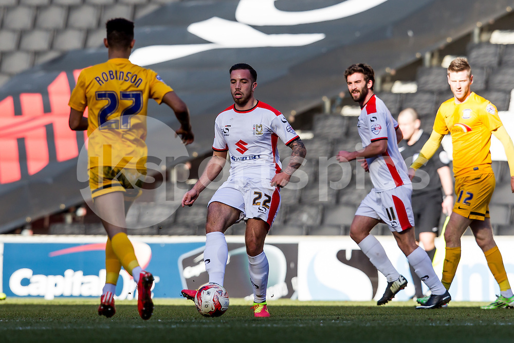 Samir Carruthers of MK Dons plays the ball during the Sky Bet League 1 match between Milton Keynes Dons and Preston North End at stadium:mk, Milton Keynes, England on 7 March 2015. Photo by Gareth  Brown.