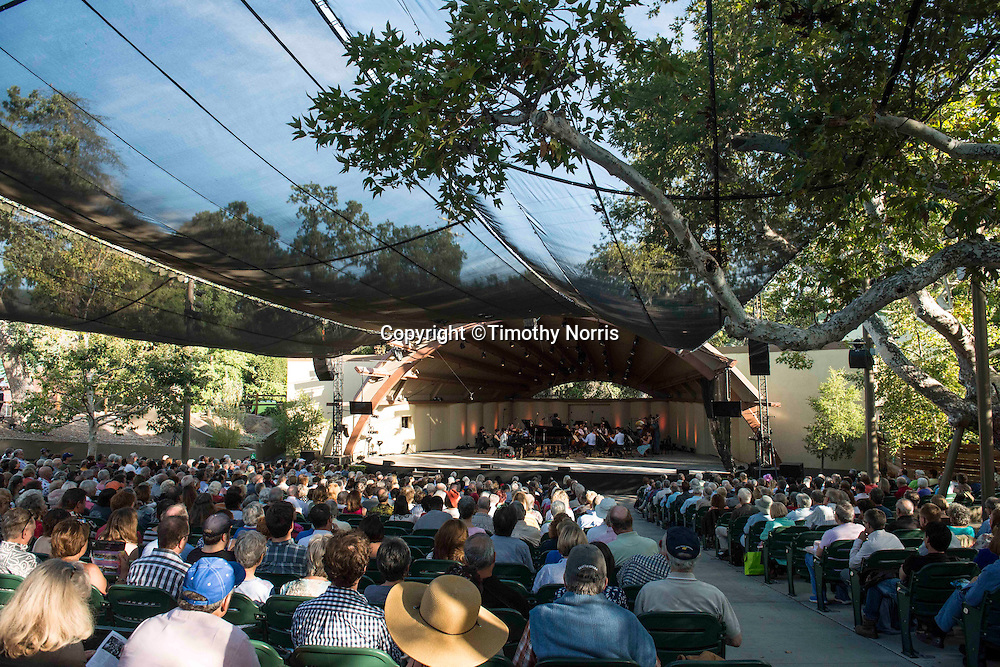 "Timo Andres (piano) and The Knights, conducted by Eric Jacobsen, perform Mozart's ""Coronation"" concerto, re-composed by Timo Andres at the 68th Ojai Music Festival at Libbey Bowl on June 14, 2014 in Ojai, California."