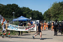 Activists from HS2 Rebellion and Extinction Rebellion UK pass a HS2 road closure as they take part in a 'Rebel Trail' hike along the route of the HS2 high-speed rail link on 26th June 2020 in Harefield, United Kingdom. The activists, who departed from Birmingham on 20th June and will arrive outside Parliament in London on 27th June, are protesting against the environmental impact of the high-speed rail link and questioning the viability of the £100bn+ project. (photo by Mark Kerrison/In Pictures via Getty Images)