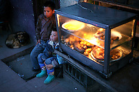 Two young boys hang out on the streets of the barrio Ciudad Bolivar in southern Bogotá on Saturday, September 23, 2006. (Photo/Scott Dalton)