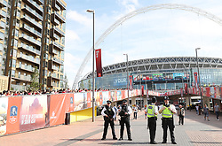 Police presence outside the stadium before the Emirates FA Cup Final at Wembley Stadium, London.