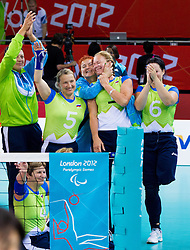 Regina Terbuc Roudi of Slovenia, Bogomira Jakin of Slovenia, Marinka Cencelj of Slovenia,  Alenka Irsic of Slovenia, Anita Goltnik Urnaut of Slovenia, Suzana Ocepek of Slovenia  celebrate after winning the 5th - 8th place sitting volleyball match between National teams of Slovenia and Japan during Day 7 of the Summer Paralympic Games London 2012 on September 4, 2012, in ExCel Exhibition centre, London, Great Britain. Slovenia defeated Japan 3-0. (Photo by Vid Ponikvar / Sportida.com)