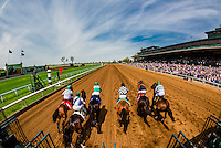Overview from starting gate of race on dirt track, Keeneland Racecourse, Lexington, Kentucky USA.