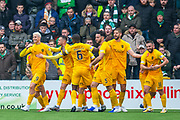 Lyndon Dykes (#9) of Livingston FC and his team mates celebrate in front of the Celtic fans after he scores Livingston's second goal during the Ladbrokes Scottish Premiership match between Livingston FC and Celtic FC at The Tony Macaroni Arena, Livingston, Scotland on 6 October 2019.