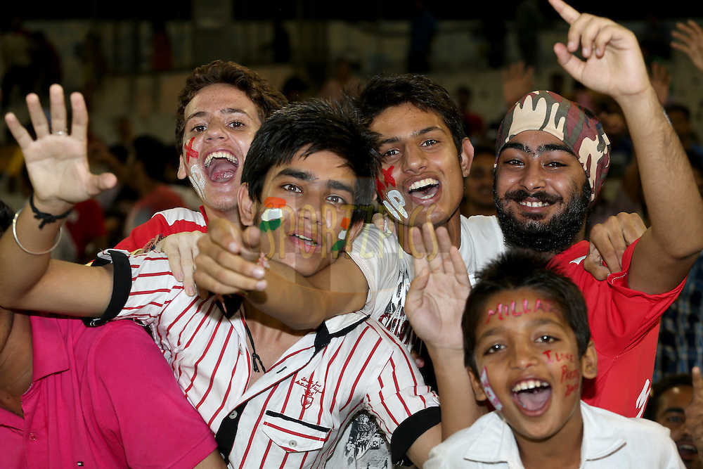 Crowd enjoying the atmosphere during match 5 of the Oppo Champions League Twenty20 between the Kings XI Punjab and the Barbados Tridents held at the Punjab Cricket Association Stadium, Mohali, India on the 20th September 2014. Photo by:  Jacques Rossouw / Sportzpics/ CLT20<br /> <br /> <br /> Image use is subject to the terms and conditions as laid out by the BCCI/ CLT20.  The terms and conditions can be downloaded here:<br /> <br /> http://sportzpics.photoshelter.com/gallery/CLT20-Image-Terms-and-Conditions-2014/G0000IfNJn535VPU/C0000QhhKadWcjYs