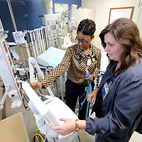 Dr. Lisa-Gaye Thomas, pediatric intensivist, and Change Nurse, Amy Burks, work with a breathing machine inside one of the pediatric ICU rooms at the North Mississippi Medical Cnter on Thursday morning in Tupelo.