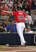 ATLANTA, GA - JUNE 08:  Second baseman Dan Uggla #26 of the Atlanta Braves points to left fielder and teammate Jason Heyward (not pictured) after Heyward's double during the game against the Toronto Blue Jays at Turner Field on June 8, 2012 in Atlanta, Georgia.  (Photo by Mike Zarrilli/Getty Images)