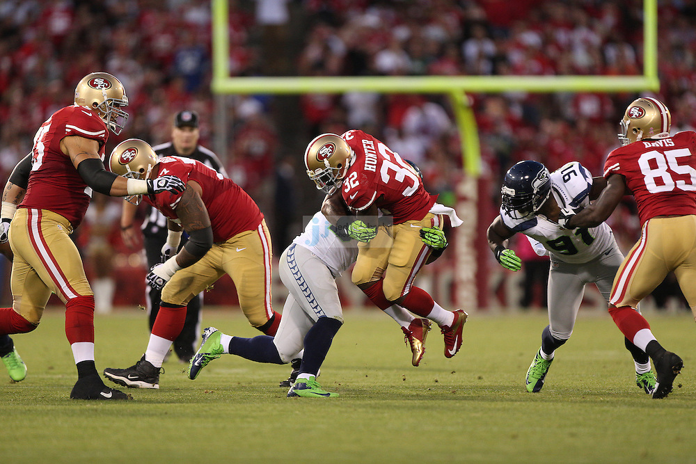 San Francisco 49ers running back Kendall Hunter (32) runs against the Seattle Seahawks on Thursday, Oct. 18, 2012 at Candlestick Park in San Francisco. (AP Photo/Jed Jacobsohn)