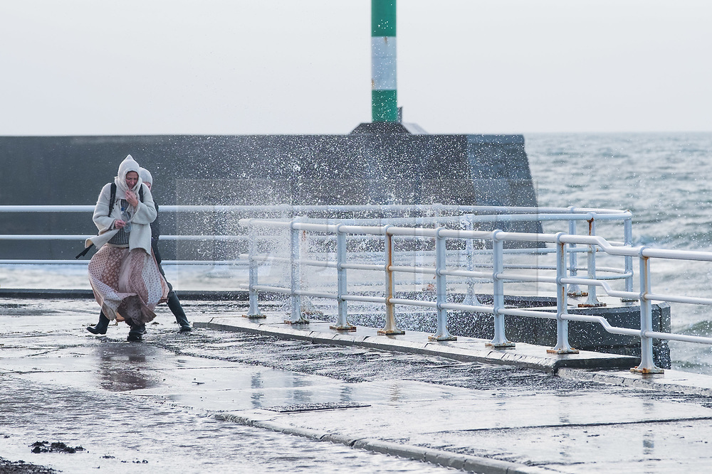 © Licensed to London News Pictures. 13/01/2019. Aberystwyth, UK. A blustery day in Aberystwyth on the west Wales coastline, with winds gusting up to gale force at times, driving huge waves into the seafront promenade at high tide. Photo credit: Keith Morris/LNP