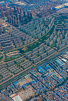 Aerial view of densely populated Kunming, Yunnan Province, China. Kunming is the capital of and largest city in Yunnan Province. It has a population of approximately 4 million people.