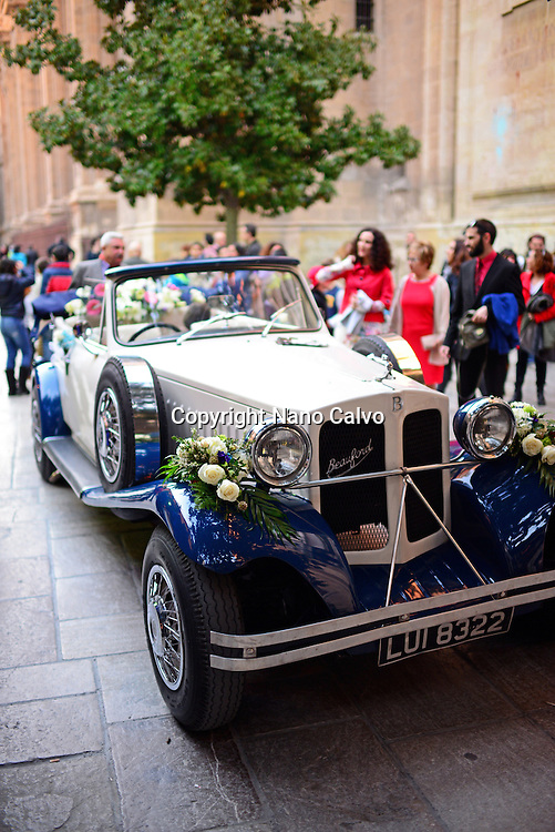 Classical car in front of church for wedding celebration, Granada, Spain