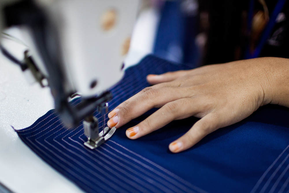 A student practice to sew patterns using a sewing machine.  Scenes at the Development Center for Human Resources and Product Industry Enterprises or (Balai Pengembangan SDM & Produk IKM), a government center that provide individuals with the necessary training and experience to work in the garment industry.  Semarang, Indonesia.  May 14, 2013.