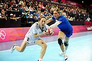 DESCRIZIONE : Handball Jeux Olympiques Londres Quart de Finale<br /> GIOCATORE : Woo Hee<br /> SQUADRA : Coree Femme<br /> EVENTO : Handball Jeux Olympiques<br /> GARA : Coree Russie<br /> DATA : 07 08 2012<br /> CATEGORIA : handball Jeux Olympiques<br /> SPORT : HANDBALL<br /> AUTORE : JF Molliere <br /> Galleria : France JEUX OLYMPIQUES 2012 Action<br /> Fotonotizia : France Handball Femme Jeux Olympiques Londres Quart de Finale Copper Box<br /> Predefinita :