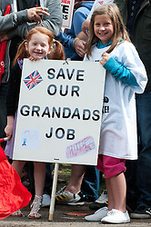 © Licensed to London News Pictures. 23/7/2011. Derby, UK. Two girls hold a sign during a march in Derby city centre. Union members and members of the general public marched today (23/07/2011) in Derby against job cuts at Bombardier, the UK's last remaining train maker. Approximately 1400 jobs are due to be cut at Bombardier after German manufacturer Siemens were announced as the preferred bidder for the Government Thameslink contract worth an estimated £1.4bn. Photo credit : Tim Goode/LNP