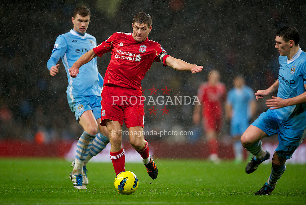 MANCHESTER, ENGLAND - Tuesday, January 3, 2012: Liverpool's captain Steven Gerrard in action against Manchester City during the Premiership match at the City of Manchester Stadium. (Pic by David Rawcliffe/Propaganda)