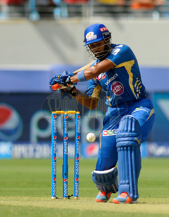 Aditya Tare of the Mumbai Indians bats during match 5 of the Pepsi Indian Premier League Season 7 between the Royal Challengers Bangalore and the Mumbai Indians held at the Dubai International Cricket Stadium, Dubai, United Arab Emirates on the 19th April 2014<br /> <br /> Photo by Pal Pillai / IPL / SPORTZPICS