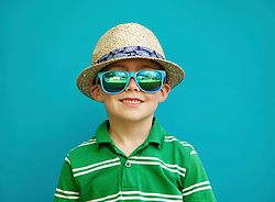 Smiling Boy Wearing Straw Hat and Sunglasses