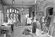 Men choosing, waxing and fitting skis at the Ski Hawk School at the Chateau Frontenac, photograph, 1945, from the Archives of the Chateau Frontenac, Quebec City, Quebec, Canada. The Chateau Frontenac opened in 1893 and was designed by Bruce Price as a chateau style hotel for the Canadian Pacific Railway company or CPR. It was extended in 1924 by William Sutherland Maxwell. The building is now a hotel, the Fairmont Le Chateau Frontenac, and is listed as a National Historic Site of Canada. The Historic District of Old Quebec is listed as a UNESCO World Heritage Site. Copyright Archives Chateau Frontenac / Manuel Cohen