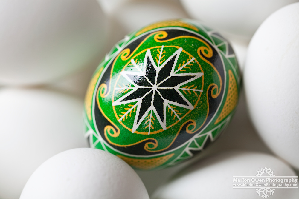 Closeup of Ukraine Easter egg, nestled in bowl of white eggs, Kodiak Island, Alaska.