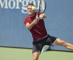 August 22, 2017 - New York, New York, United States - Tobias Kamke of Germany returns ball during qualifying game against Noah Rubin of USA at US Open 2017  (Credit Image: © Lev Radin/Pacific Press via ZUMA Wire)