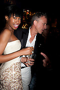 TOLULA ADEYEMI; PATRICK COX,  DSquared2 Launch of their Classic collection. Tramp. Jermyn St. London. 29 June 2011. <br /> <br />  , -DO NOT ARCHIVE-© Copyright Photograph by Dafydd Jones. 248 Clapham Rd. London SW9 0PZ. Tel 0207 820 0771. www.dafjones.com.