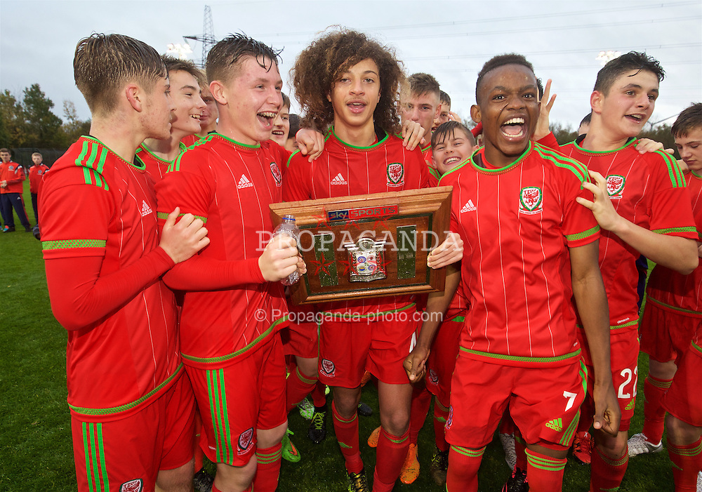 NEWPORT, WALES - Thursday, November 5, 2015: Wales' captain Ethan Ampadu leads the celebrations retaining the Victory Shield following a 3-1 victory over Northern Ireland during the Under-16's Victory Shield International match at Dragon Park. Kieron Holsgrove, Rabbi Matonda. (Pic by David Rawcliffe/Propaganda)