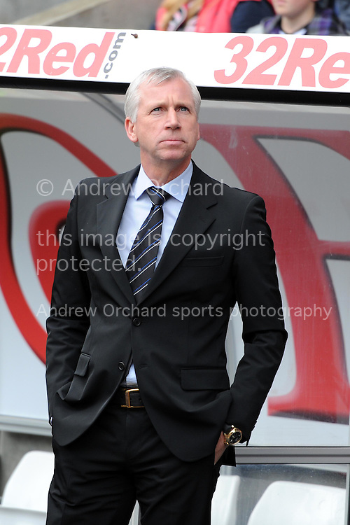 Newcastle Utd manager Alan Pardew looks on before k/o. Barclays Premier league,  Swansea city v Newcastle Utd at the Liberty  stadium in Swansea, South Wales on Friday 6th April  2012.  pic by Andrew Orchard, Andrew Orchard sports photography,