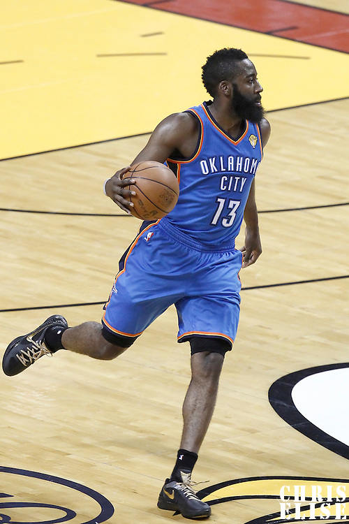 17 June 2012: Oklahoma City Thunder guard James Harden (13) brings the ball upcourt during the Miami Heat 91-85 victory over the Oklahoma City Thunder, in Game 3 of the 2012 NBA Finals, at the AmericanAirlinesArena, Miami, Florida, USA.