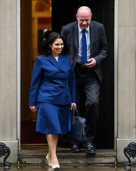 © Licensed to London News Pictures. 08/03/2017. London, UK. Secretary of State for International Development PRITI PATEL (L) and Secretary of State for Work and Pensions DAMIAN GREEN (R) leave Downing Street following a cabinet meeting before British chancellor Philip Hammond delivers his 2017 Budget to Parliament. Photo credit: Ben Cawthra/LNP