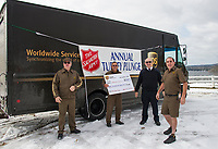 Team UPS Scott Emerson, Mark Emery and Jim Gentile are thanked by Captain Scott McNeil of the Salvation Army Saturday morning at Bartlett Beach as the UPS team continued on the tradition for their 14th year.  (Karen Bobotas/for the Laconia Daily Sun)