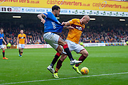 Curtis Main (#9) of Motherwell FC holds off Connor Goldson (#6) of Rangers FC during the Ladbrokes Scottish Premiership match between Motherwell and Rangers at Fir Park, Motherwell, Scotland on 26 August 2018.
