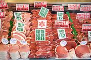 Meat display in butcher's shop window