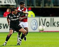 24-11-2007: Voetbal:AZ-WILLEM II: ALKMAAR<br /> Kew Jaliens houdt Said Boutahar vast<br /> Foto: Geert van Erven
